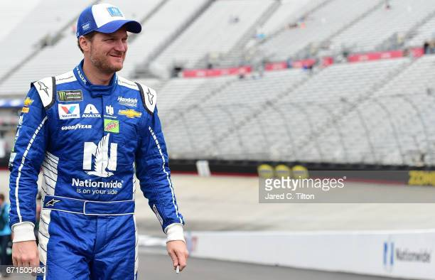 Dale Earnhardt Jr driver of the Nationwide Chevrolet walks through the garage area during practice for the Monster Energy NASCAR Cup Series Food City...
