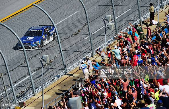 Dale Earnhardt Jr driver of the Nationwide Chevrolet waves to fans after winning the NASCAR Sprint Cup Series GEICO 500 at Talladega Superspeedway on...