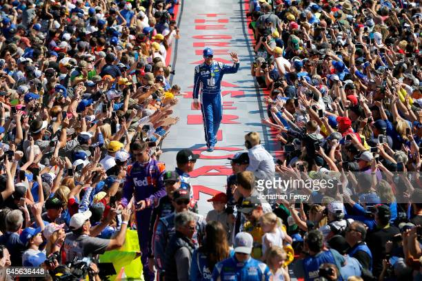Dale Earnhardt Jr driver of the Nationwide Chevrolet waves to the crowd during driver introduction before the 59th Annual DAYTONA 500 at Daytona...