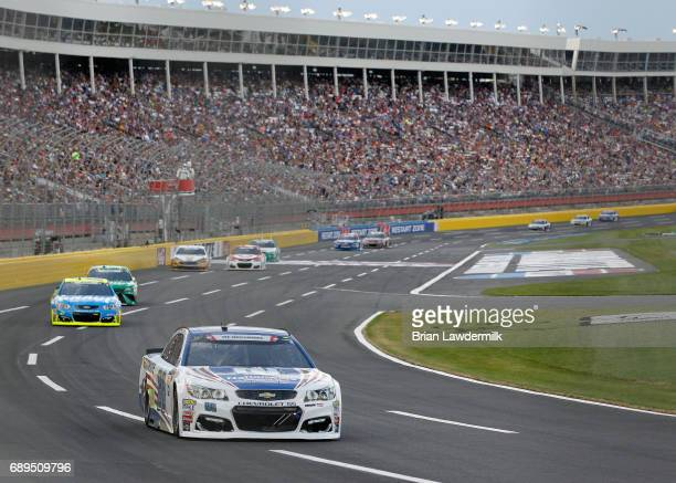 Dale Earnhardt Jr driver of the Nationwide Patriotic Chevrolet leads a pack of cars during the Monster Energy NASCAR Cup Series CocaCola 600 at...