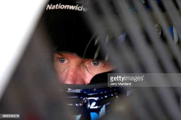 Dale Earnhardt Jr driver of the Nationwide Patriotic Chevrolet sits in his car during practice for the Monster Energy NASCAR Cup Series CocaCola 600...