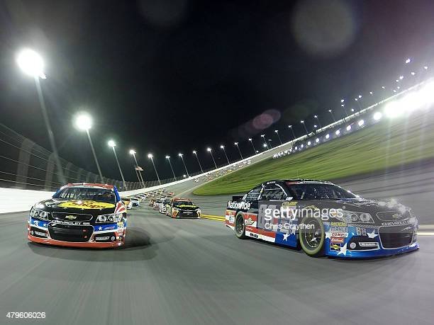 Dale Earnhardt Jr driver of the Nationwide Stars and Stripes Chevrolet and Austin Dillon driver of the Bass Pro Shops Chevrolet lead the field prior...