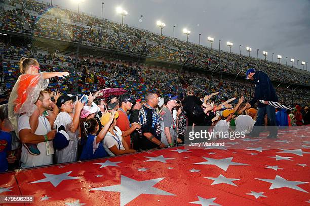 Dale Earnhardt Jr driver of the Nationwide Stars and Stripes Chevrolet is introduced to fans prior to the NASCAR Sprint Cup Series Coke Zero 400...