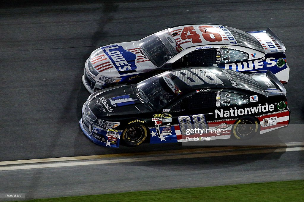 <a gi-track='captionPersonalityLinkClicked' href=/galleries/search?phrase=Dale+Earnhardt+Jr.&family=editorial&specificpeople=171293 ng-click='$event.stopPropagation()'>Dale Earnhardt Jr.</a>, driver of the #88 Nationwide Stars and Stripes Chevrolet, races <a gi-track='captionPersonalityLinkClicked' href=/galleries/search?phrase=Jimmie+Johnson+-+Nascar+Race+Driver&family=editorial&specificpeople=171519 ng-click='$event.stopPropagation()'>Jimmie Johnson</a>, driver of the #48 Lowe's Patriotic Chevrolet, during the NASCAR Sprint Cup Series Coke Zero 400 Powered by Coca-Cola at Daytona International Speedway on July 6, 2015 in Daytona Beach, Florida.