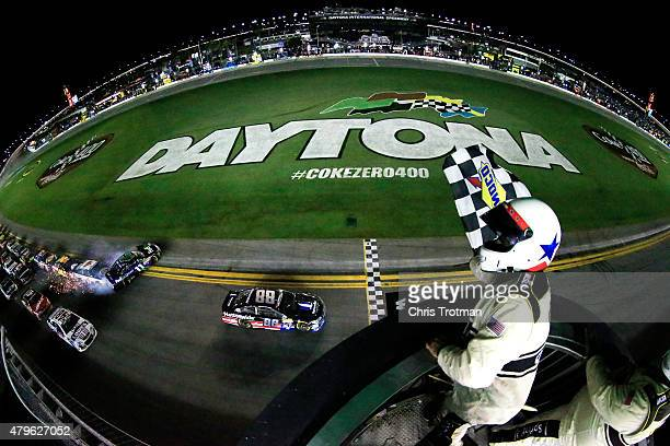 Dale Earnhardt Jr driver of the Nationwide Stars and Stripes Chevrolet takes the checkered flag to win the NASCAR Sprint Cup Series Coke Zero 400...