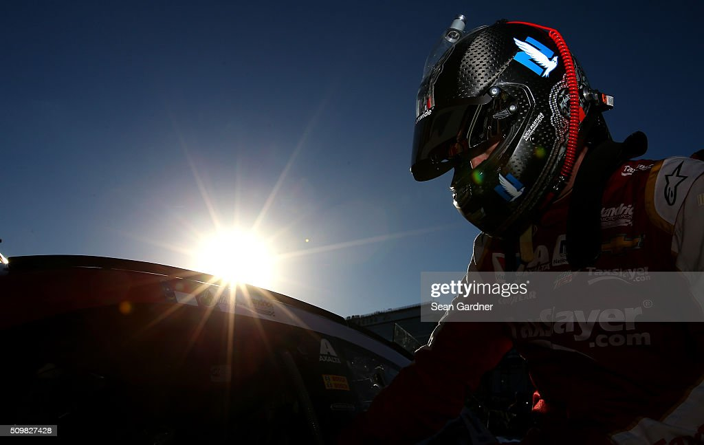 <a gi-track='captionPersonalityLinkClicked' href=/galleries/search?phrase=Dale+Earnhardt+Jr.&family=editorial&specificpeople=171293 ng-click='$event.stopPropagation()'>Dale Earnhardt Jr.</a>, driver of the #88 Taxslayer.com Chevrolet, climbs into his car during practice for the NASCAR Sprint Cup Series Sprint Unlimited at Daytona International Speedway on February 12, 2016 in Daytona Beach, Florida.