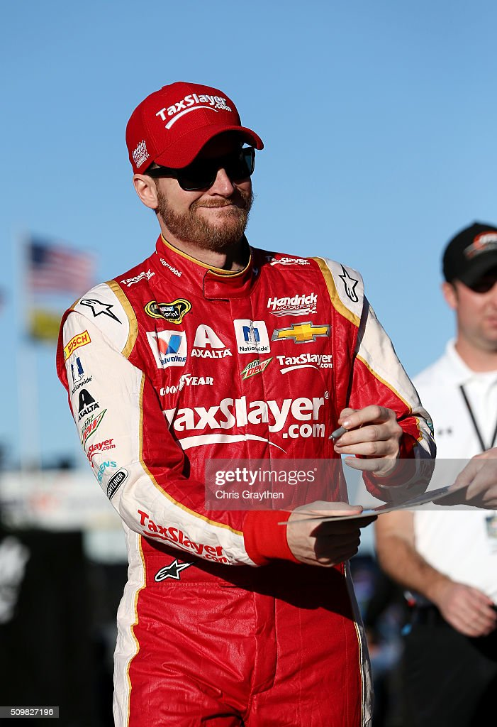 <a gi-track='captionPersonalityLinkClicked' href=/galleries/search?phrase=Dale+Earnhardt+Jr.&family=editorial&specificpeople=171293 ng-click='$event.stopPropagation()'>Dale Earnhardt Jr.</a>, driver of the #88 Taxslayer.com Chevrolet, signs autographs for fans during practice for the NASCAR Sprint Cup Series Sprint Unlimited at Daytona International Speedway on February 12, 2016 in Daytona Beach, Florida.