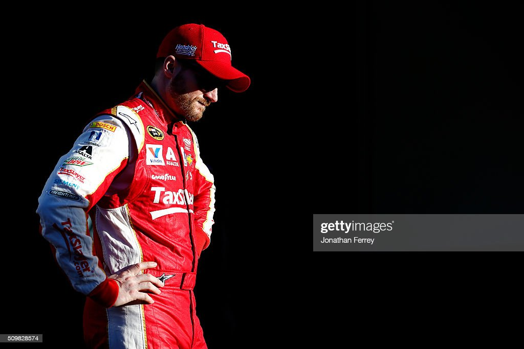 Dale Earnhardt Jr., driver of the #88 Taxslayer.com Chevrolet, stands in the garage area during practice for the NASCAR Sprint Cup Series Sprint Unlimited at Daytona International Speedway on February 12, 2016 in Daytona Beach, Florida.