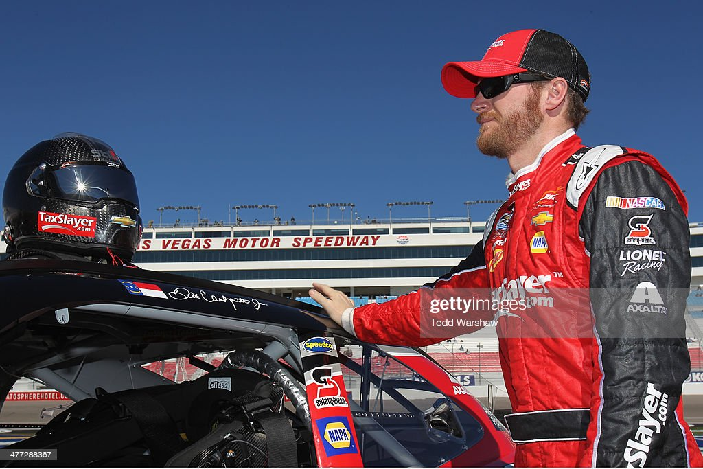<a gi-track='captionPersonalityLinkClicked' href=/galleries/search?phrase=Dale+Earnhardt+Jr.&family=editorial&specificpeople=171293 ng-click='$event.stopPropagation()'>Dale Earnhardt Jr.</a>, driver of the #88 TaxSlayer.com Chevrolet, stands on the grid during qualifying for the NASCAR Nationwide Series Boyd Gaming 300 at Las Vegas Motor Speedway on March 8, 2014 in Las Vegas, Nevada.