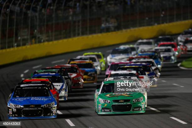 Dale Earnhardt Jr driver of the Time Warner Cable Chevrolet and Kasey Kahne driver of the Quaker State Chevrolet during the NASCAR Sprint Cup Series...