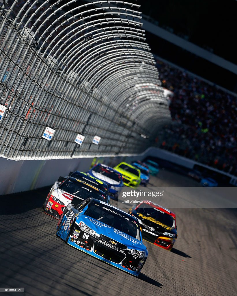 Dale Earnhardt Jr., driver of the #88 Time Warner Cable Chevrolet, leads a pack of cars during the NASCAR Sprint Cup Series Sylvania 300 at New Hampshire Motor Speedway on September 22, 2013 in Loudon, New Hampshire.