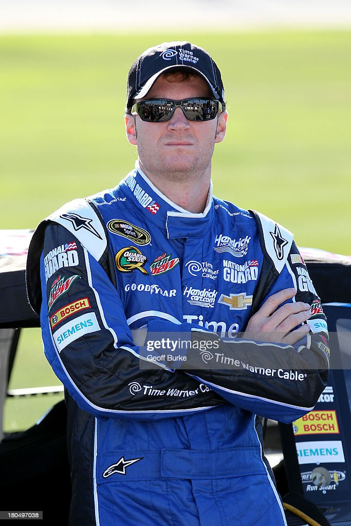 <a gi-track='captionPersonalityLinkClicked' href=/galleries/search?phrase=Dale+Earnhardt+Jr.&family=editorial&specificpeople=171293 ng-click='$event.stopPropagation()'>Dale Earnhardt Jr.</a>, driver of the #88 Time Warner Cable Chevrolet, looks on during qualifying for the NASCAR Sprint Cup Series Geico 400 at Chicagoland Speedway on September 13, 2013 in Joliet, Illinois.