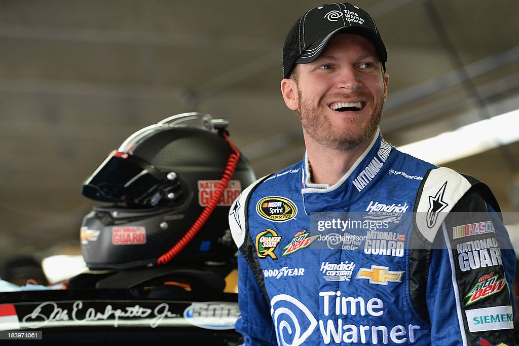 Dale Earnhardt Jr driver of the Time Warner Cable Chevrolet stands in the garage area during practice for the NASCAR Sprint Cup Series Bank of...