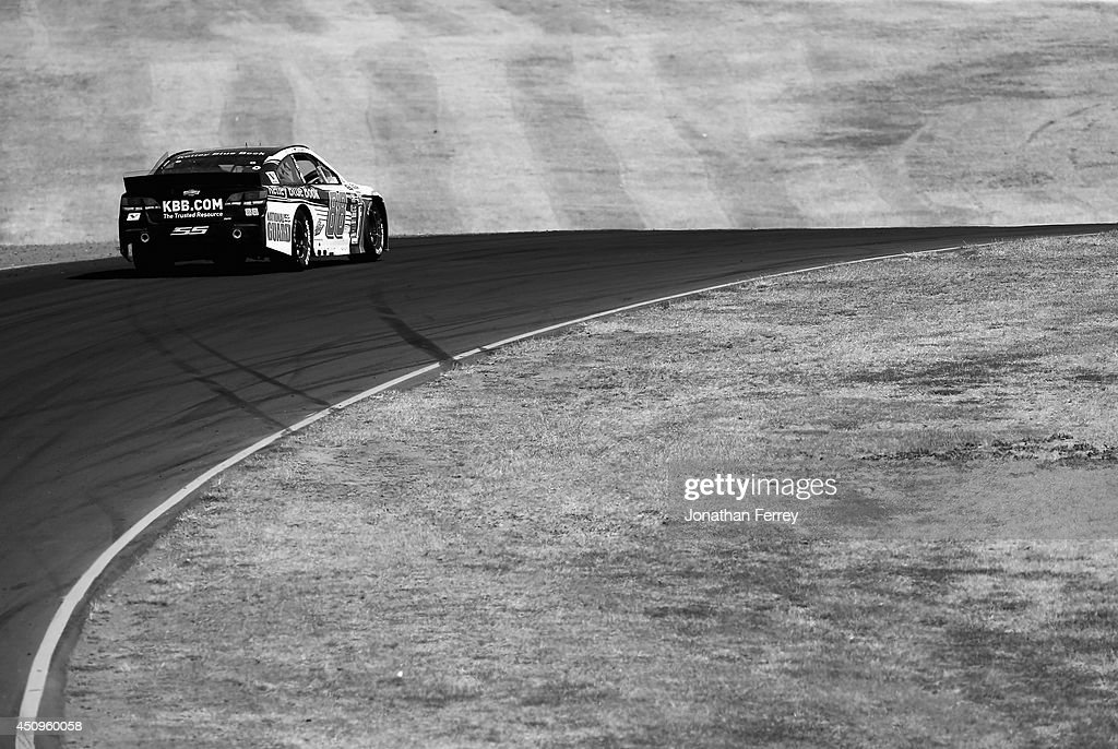 Dale Earnhardt Jr., drives driver of the #88 Kelley Blue Book Chevrolet, cduring practice for the NASCAR Sprint Cup Series Toyota/Save Mart 350 at Sonoma Raceway on June 20, 2014 in Sonoma, California.