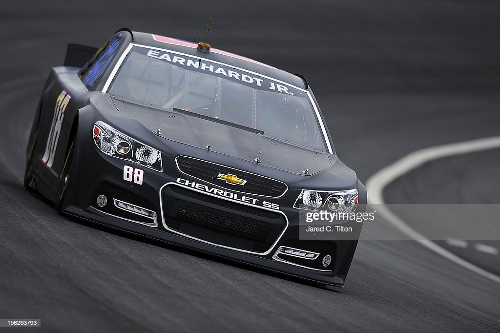 <a gi-track='captionPersonalityLinkClicked' href=/galleries/search?phrase=Dale+Earnhardt+Jr.&family=editorial&specificpeople=171293 ng-click='$event.stopPropagation()'>Dale Earnhardt Jr.</a> drives the Hendrick Motorsports Chevrolet during testing at Charlotte Motor Speedway on December 12, 2012 in Concord, North Carolina.
