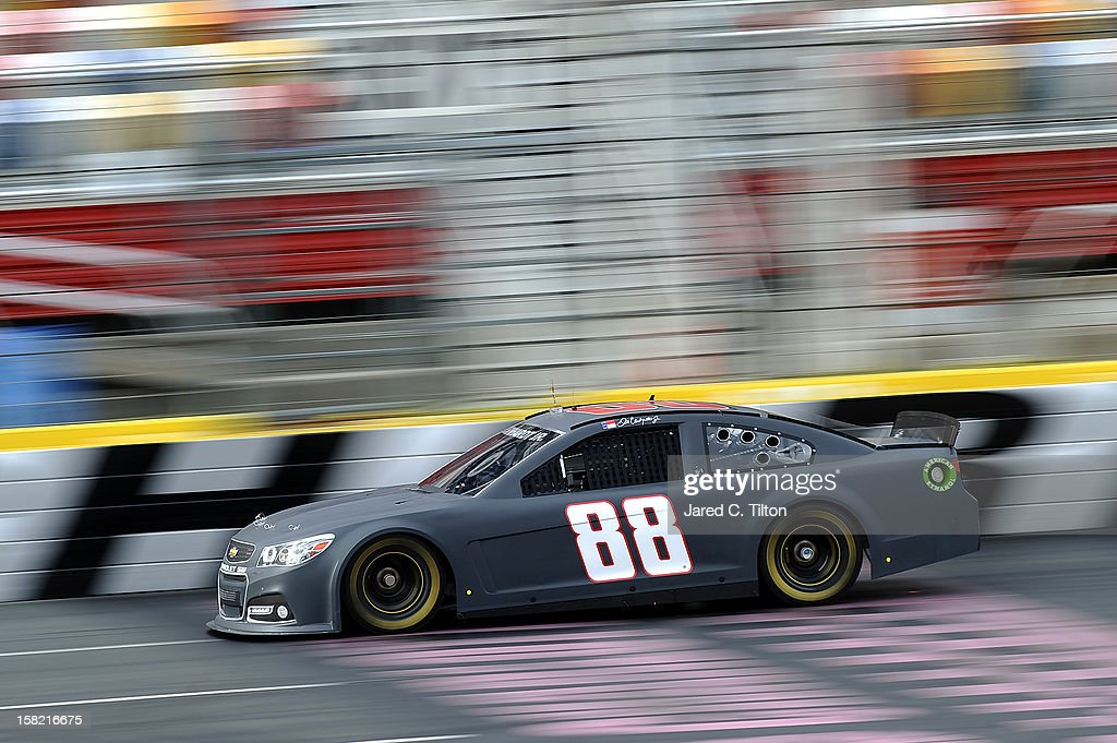 Dale Earnhardt Jr. drives the #88 National Guard Chevrolet during testing at Charlotte Motor Speedway on December 11, 2012 in Concord, North Carolina.