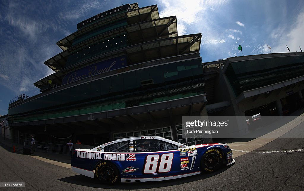 Dale Earnhardt Jr. drives the #88 National Guard Chevrolet through the garage area during practice for the NASCAR Sprint Cup Series Samuel Deeds 400 At The Brickyard at Indianapolis Motor Speedway on July 26, 2013 in Indianapolis, Indiana.