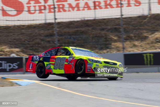 Dale Earnhardt Jr gets two wheels up as he exits Turn 4A at the Toyota/Save Mart 350 practice on June 23 2017 at Sonoma Raceway in Sonoma CA