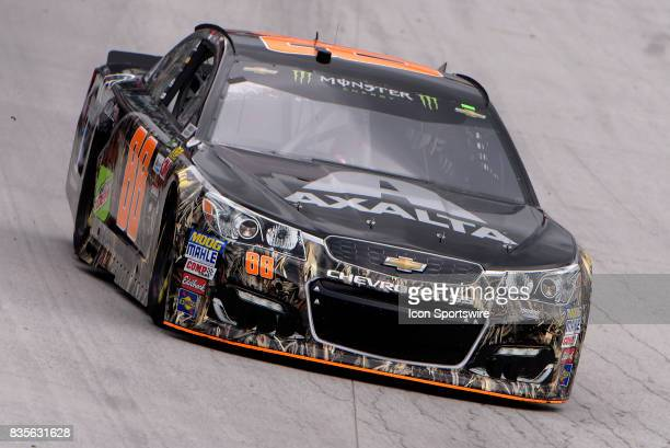 Dale Earnhardt Jr Hendrick Motorsports Chevrolet SS dives into turn three during the practice session for the Bass Pro Shops NRA Night Race on August...