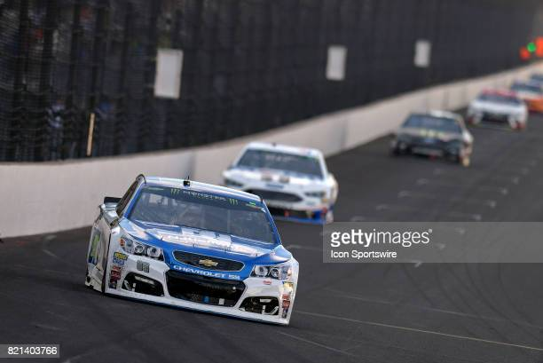 Dale Earnhardt Jr Hendrick Motorsports Chevrolet SS leads a pack of cars down the front stretch during the NASCAR Monster Energy Cup Series Brantley...