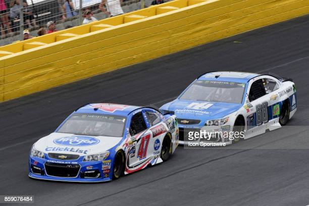 Dale Earnhardt Jr Hendrick Motorsports Chevrolet SS runs behind AJ Allmendinger JTG Daugherty Racing Kroger ClickList Chevrolet SS during the Monster...