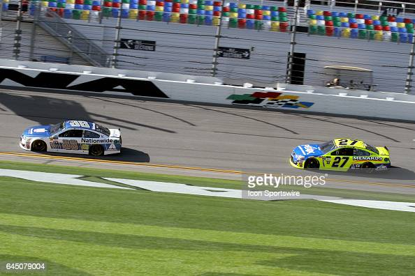 Dale Earnhardt Jr leads Paul Menard through the front stretch during practice for the NASCAR Monster Energy Cup Series Daytona 500 on February 24 at...