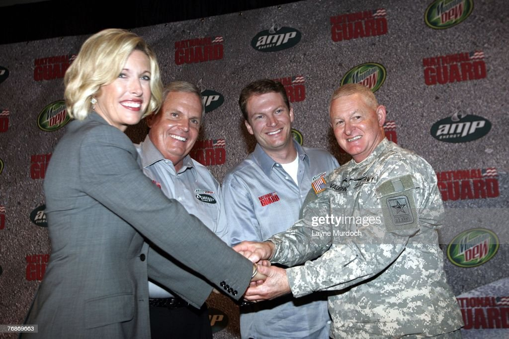 Dale Earnhardt Jr of the Hendrick Motorsports Racing Team poses with Dawn Hudson of Pepsi Rick Hendrick and Lt Gen Clyde A Vaughn of the National...