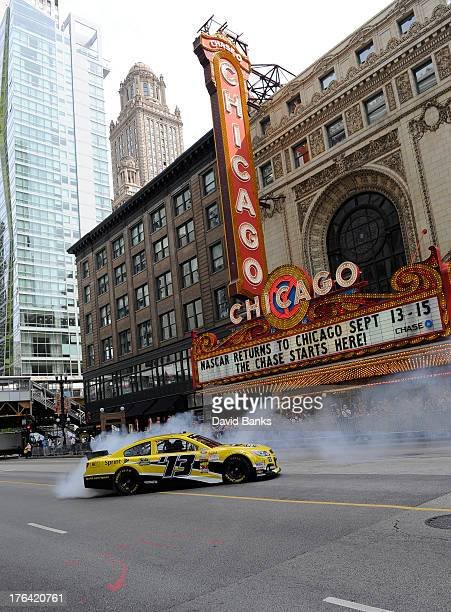 Dale Earnhardt Jr performs a burnout in the Sprint Cup Series car in front of the iconic Chicago Theater on State Street on August 12 2012 in Chicago...