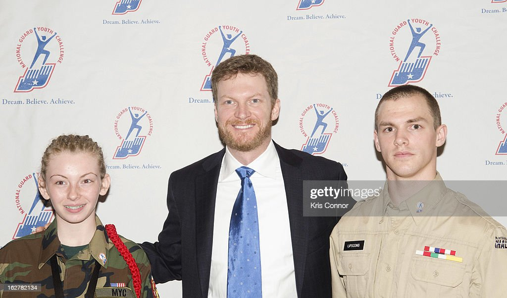 Dale Earnhardt Jr (C) poses with cadets during the 2013 ChalleNGe Champions Gala at JW Marriott Hotel on February 26, 2013 in Washington, DC.