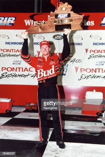 Dale Earnhardt Jr shows off the winner's trophy after winning the 2000 Pontiac Excitement 400 at Richmond International Raceway