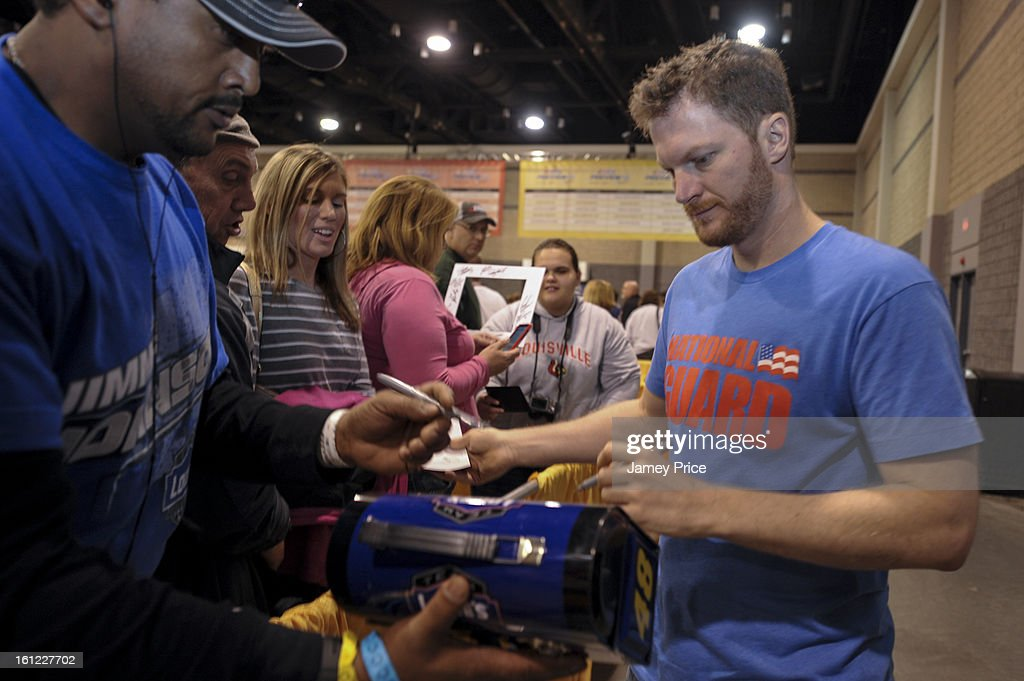 <a gi-track='captionPersonalityLinkClicked' href=/galleries/search?phrase=Dale+Earnhardt+Jr.&family=editorial&specificpeople=171293 ng-click='$event.stopPropagation()'>Dale Earnhardt Jr.</a> signs autographs on Saturday afternoon at the NASCAR Hall of Fame on February 9, 2013 in Charlotte, North Carolina.