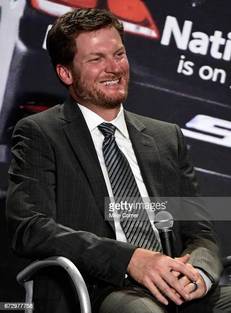 Dale Earnhardt Jr smiles in response to a question from the media during a press conference to announce his retirement from NASCAR after the 2017...