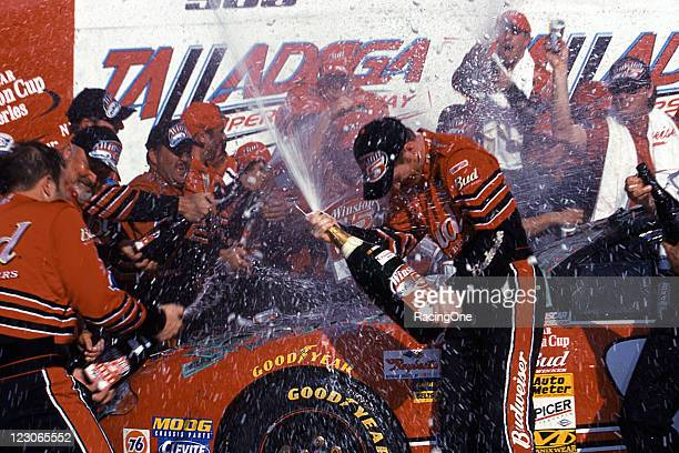 Dale Earnhardt Jr sprays his crew with champagne in victory lane after he won the EA Sports 500 NASCAR Cup race at Talladega Superspeedway