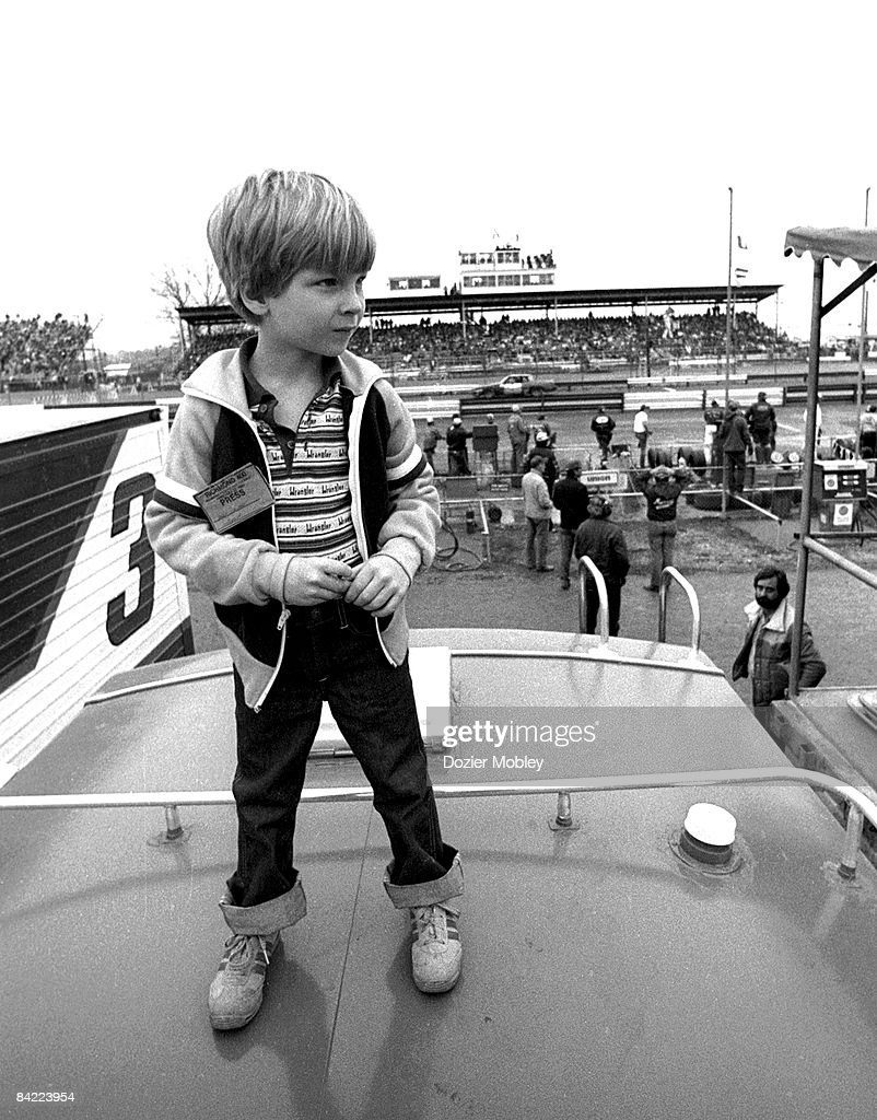<a gi-track='captionPersonalityLinkClicked' href=/galleries/search?phrase=Dale+Earnhardt+Jr.&family=editorial&specificpeople=171293 ng-click='$event.stopPropagation()'>Dale Earnhardt Jr.</a> stands atop a camper watching the race during the Richmond 400 race on February 22, 1981 at the Richmond Fairgrounds Raceway in Richmond, Virginia.