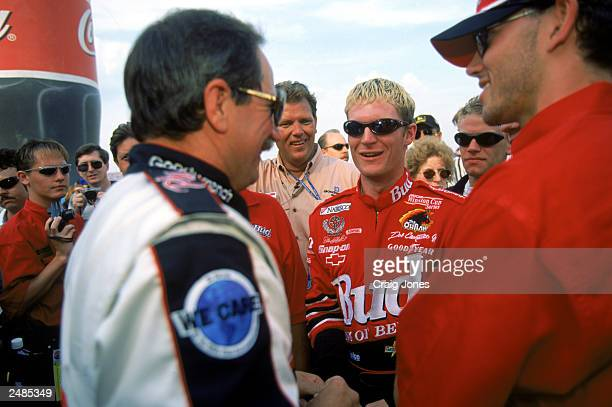 Dale Earnhardt Jr talks with his father Dale Earnhardt Sr after the CocaCola 600 at the Lowe's Motor Speedway on May 30 1999 in Concord North Carolina