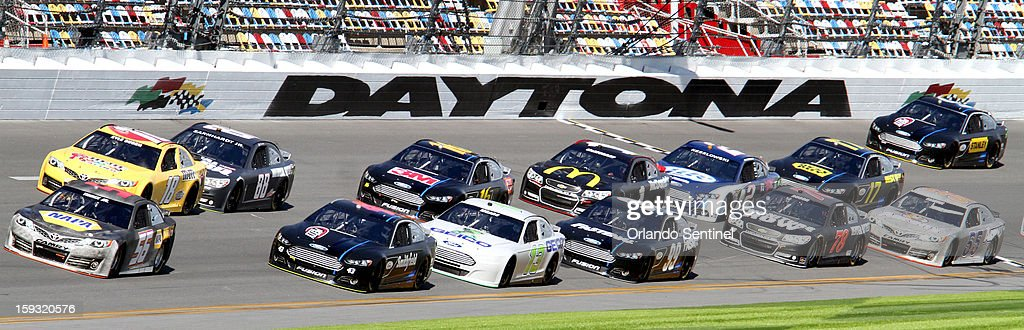 Dale Earnhardt, Jr., thrid from the left, drives during pack race testing at Daytona International Speedway in Daytona Beach, Florida, Friday, January 11, 2013. Later in the day, he caused a 12-car pile-up during test trials at the track.
