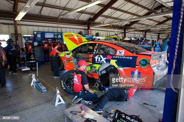 Dale Earnhardt Jr's crew is busy with a suspension change at the Toyota/Save Mart 350 practice on June 23 2017 at Sonoma Raceway in Sonoma CA