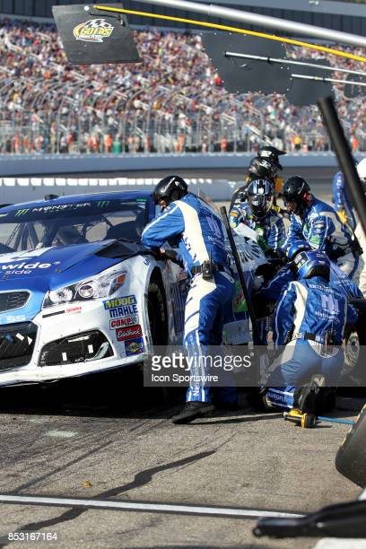Dale Earnhardt Jr's pit crew repairs accident damage during the Monster Energy NASCAR Cup Series ISM Connect 300 race on September 24 at New...
