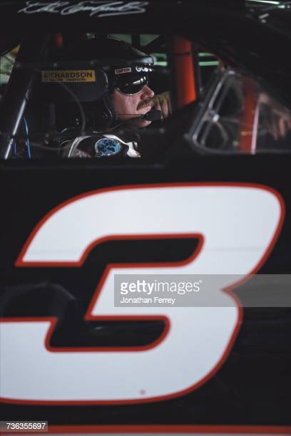 Dale Earnhardt of the United States sits aboard the GM Goodwrench Service Plus Richard Childress Racing Chevrolet Monte Carlo before the NASCAR...