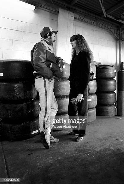 Dale Earnhardt Sr and his wife Teresa Earnhardt have a personal conversation alone in the Daytona International Speedway garage prior to the start of...