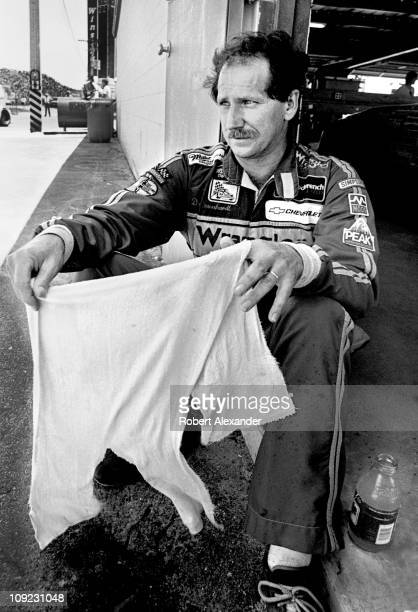 Dale Earnhardt Sr cools down in the Daytona International Speedway garage after completing the 1983 Firecracker 400 on July 4 1983 in Daytona Beach...