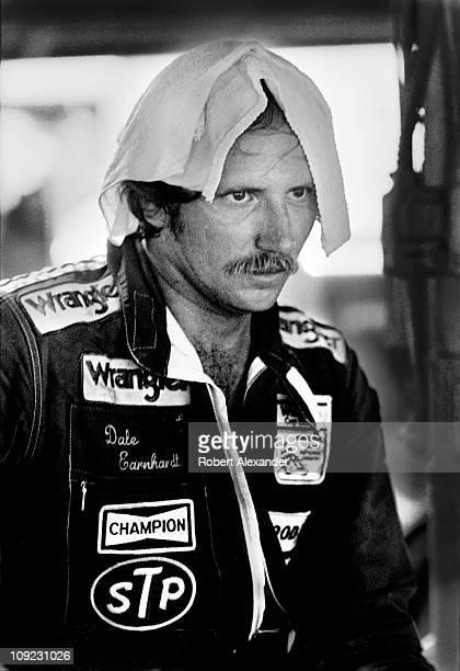Dale Earnhardt Sr driver of the Wrangler Chevrolet Monte Carlo cools off in the garage at the Daytona International Speedway after the 1984...