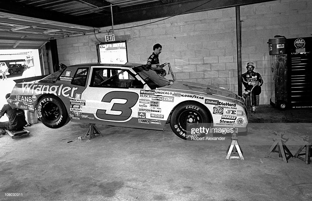 Dale Earnhardt Sr driver of the Wrangler Chevrolet Monte Carlo relaxes in the garage at the Daytona International Speedway prior to the start of the...