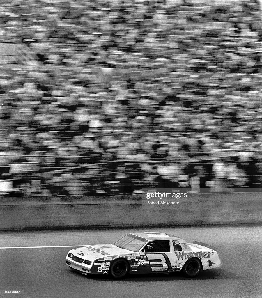 Dale Earnhardt Sr driver of the Wrangler Chevy Monte Carlo circles the track at the Daytona International Speedway during the 1984 Daytona 500 on...