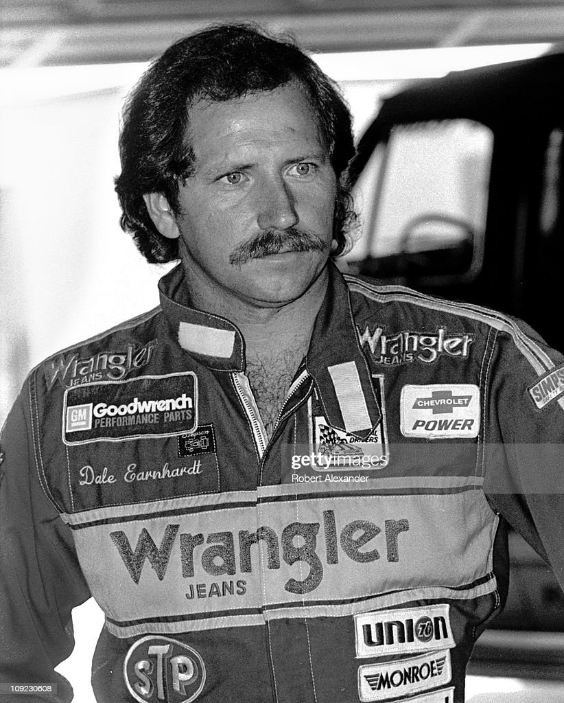 Dale Earnhardt Sr pauses in the Daytona International Speedway garage prior to the start of the 1983 Daytona 500 on February 20 1983 in Daytona Beach...