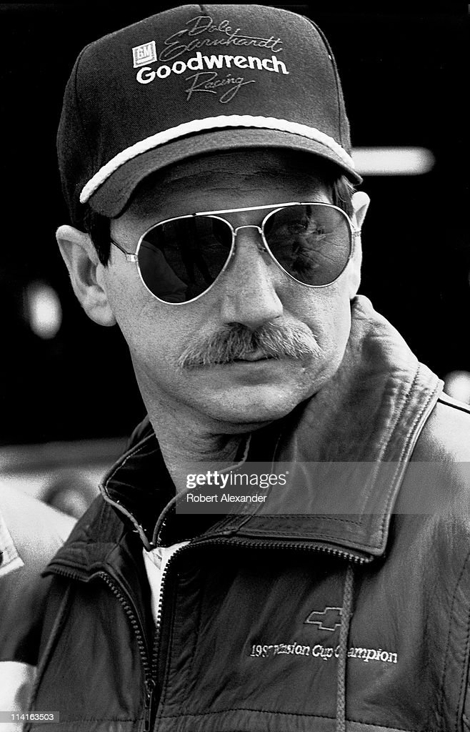 Dale Earnhardt Sr pauses in the Daytona International Speedway garage prior to the start of the 1988 Daytona 500 on February 14 1988 in Daytona Beach...
