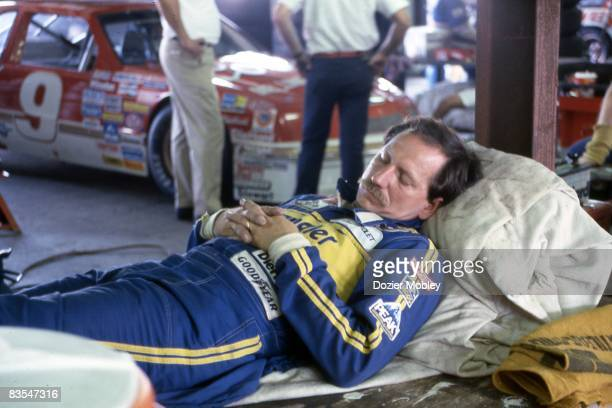 Dale Earnhardt takes a nap before the race at the Summer 500 on July 19 1987 at Pocono International Raceway in Long Pond Pennsylvania Dale's extra...