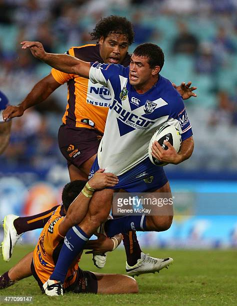Dale Finucane of the Bulldogs gets away from Sam Thaiday during the round one NRL match between the CanterburyBankstown Bulldogs and the Brisbane...