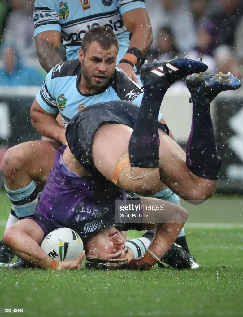 Dale Finucane of the Melbourne Storm is tackled during the round six NRL match between the Melbourne Storm and the Cronulla Sharks at AAMI Park on April 9, 2017 in Melbourne, Australia.