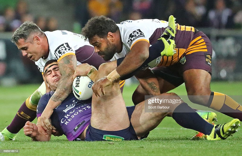 Dale Finucane of the Storm is tackled by Sam Thaiday and Corey Parker of the Broncos during the round 25 NRL match between the Melbourne Storm and the Brisbane Broncos at AAMI Park on August 26, 2016 in Melbourne, Australia.